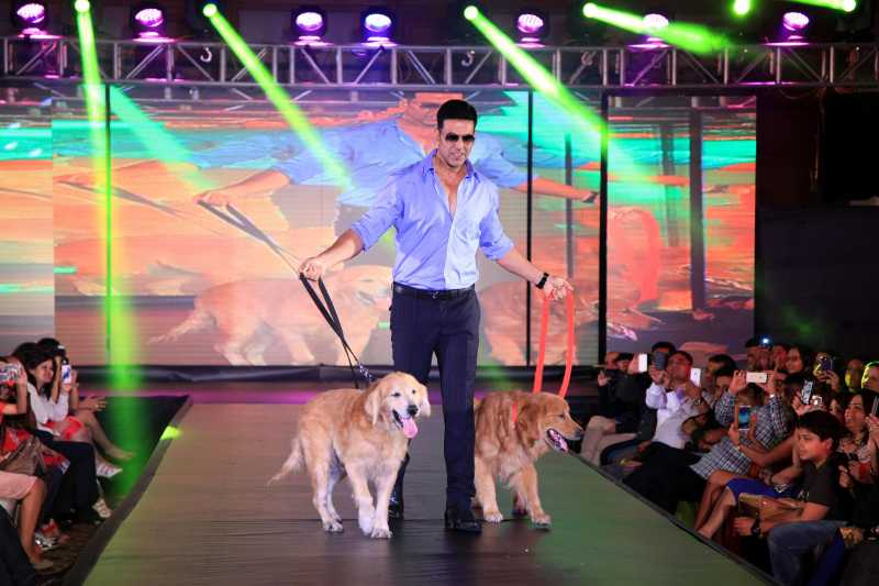 Actor Akshay Kumar walk the ramp with dogs during the promotion of film Entertainment in Bengaluru.