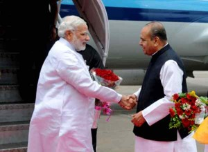 Maharashtra Governor K Sankaranarayanan receives Prime Minister Narendra Modi at Mumbai's CSIA Airport on July 21, 2014. (Photo: Sandeep Mahankal/IANS)