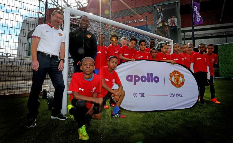 Pitch Perfect: Manchester United legends Denis Irwin and Andrew Cole at the launch of the new Apollo community pitch in the shadow of Old Trafford; the pitch is made from recycled tyre rubber