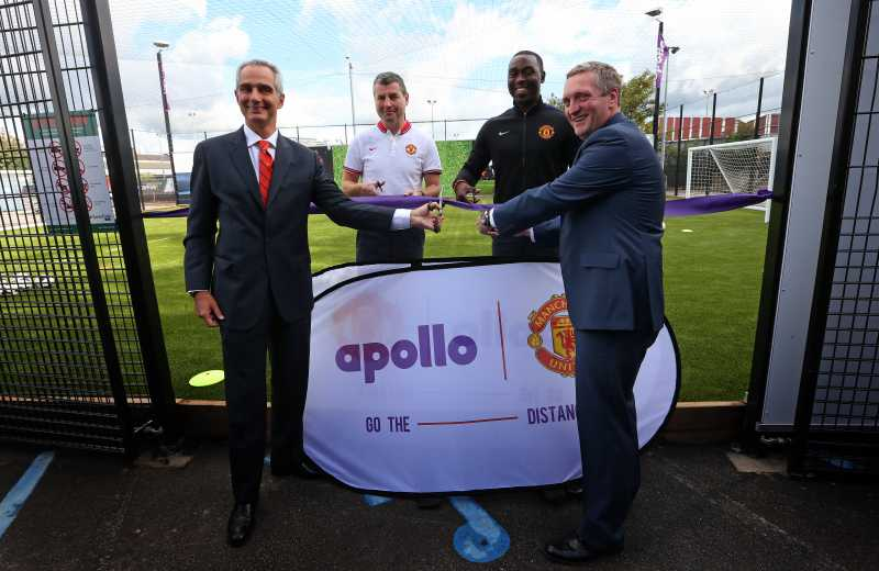 Andrew Cole, Marco Paracciani (Apollo), Jonathan Rigby (Manchester United) and Denis Irwin celebrating the recycled tyre rubber pitch release