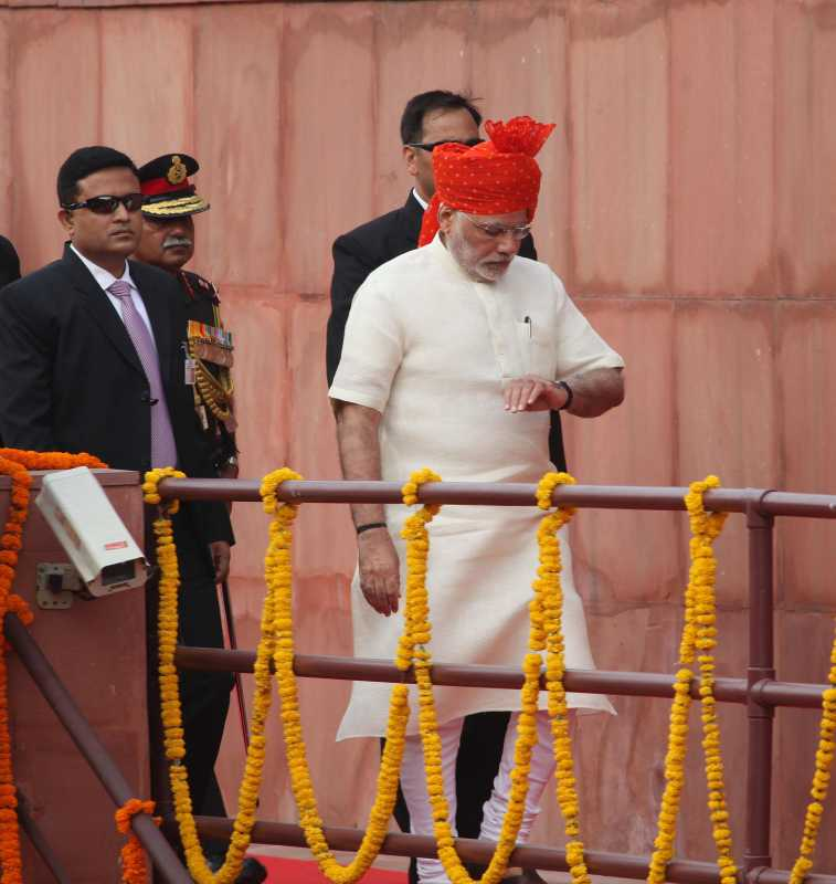Prime Minister Narendra Modi arrives at Red Fort to hoist the national flag and address the nation on Independence Day in New Delhi on Aug 15, 2014. (Photo: IANS)