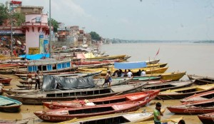 Boats remain anchored on the ghats of Ganga river in Varanasi as water level in the river is increasing; on Aug 7, 2014. (Photo: IANS)