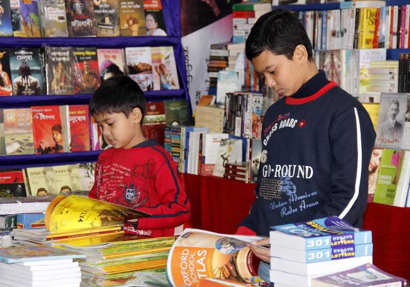 Children go through books at the 15th North East Book Fair in Guwahati