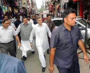 Jammu and Kashmir Chief Minister Omar Abdullah visiting Raghunath Bazar in Jammu on AUg. 9, 2014. (Photo: IANS)