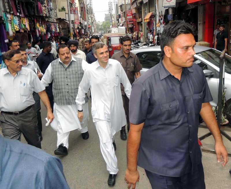Jammu and Kashmir Chief Minister Omar Abdullah visiting Raghunath Bazar in Jammu on AUg. 9, 2014. (Photo: IANS)