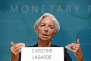 (140616) -- WASHINGTON D.C., June 16, 2014 (Xinhua) -- International Monetary Fund(IMF) Managing Director Christine Lagarde(R) speaks during a press conference at the IMF headquarters in Washington D.C., the United States, on June 16, 2014. The International Monetary Fund on Monday sharply lowered its U.S. economic growth forecasts for this year from the perviously predicted 2.8 percent to 2 percent due to a weak first quarter. (Xinhua/Yin Bogu)