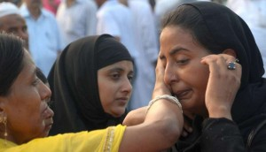 Haj pilgrims share emotional moments with their relatives ahead of leaving for Mecca at Haj House in Lucknow