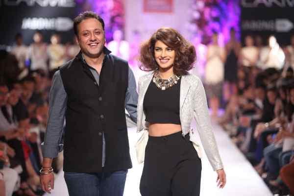 Priyanka Chopra walks on the ramp with designer Varun Bahl during his show at Lakme Fashion Week (LFW) Winter/ Festive 2014, in Mumbai, on Aug. 23, 2014. (Photo: IANS)