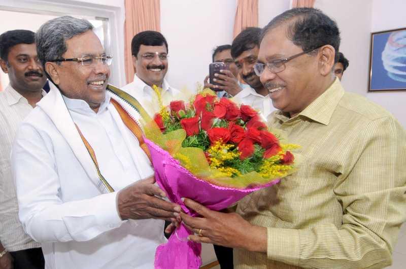 Karnataka Chief Minister Siddaramaiah being greeted by Karnataka Congress chief G.Parameshwara on his birthday in Bangalore on Aug 12, 2014. (Photo: IANS)