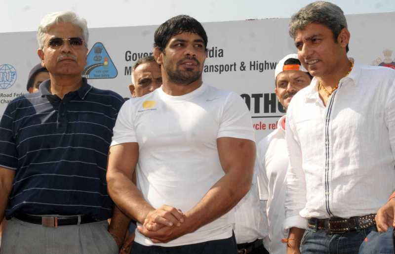 Indian wrestler Sushil Kumar with Former Indian cricketer Ajay Jadeja and Delhi Police Commissioner B.S. Bassi