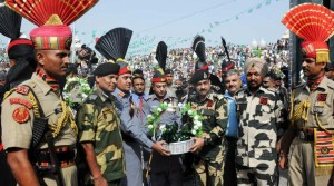 Pakistan Rangers Director General Major General Khan Tahir Javed Khan offers sweets to Border Security Force (BSF) Deputy Inspector General (DIG), M F Farooqui on Pakistani Independence Day at Indo-Pakistan border in Wagha of Punjab on Aug 14.