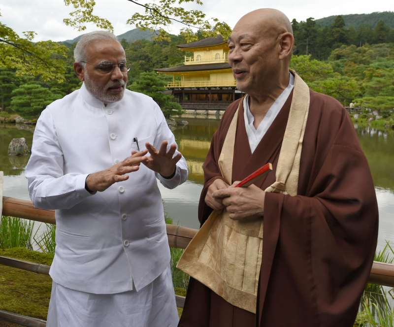 Prime Minister Narendra Modi interacts with the head priest of the Kinkaku-ji (Golden Pavilion) Temple during his visit to the temple in Kyoto, Japan on August 31, 2014. (Photo: IANS/PIB)