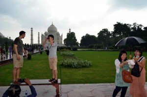 Foreign tourists enjoy themselves at Taj Mahal in Agra