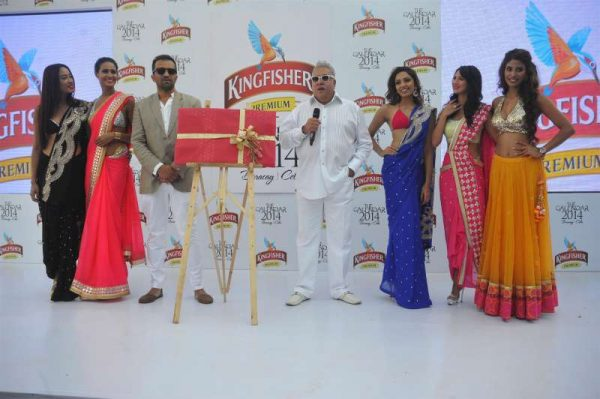 Chairman of UB Group Vijay Mallya with models during the launch of Kingfisher Calendar 2014 in Mumbai
