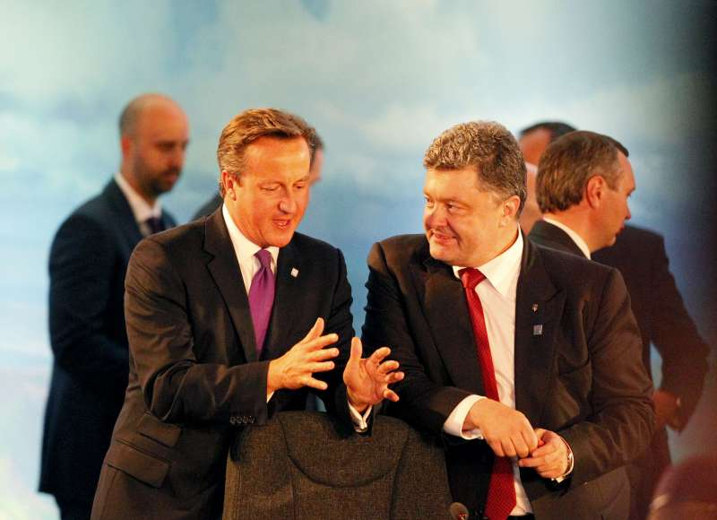 Ukrainian President Petro Poroshenko (front R) talks with British Prime Minister David Cameron prior to a meeting held by the NATO-Ukraine Commission (NUC) at the level of Heads of State and Government at the NATO Summit 2014 in Newport, Wales