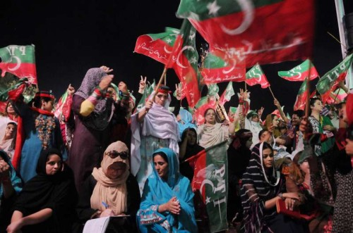Supporters of Pakistan Tehrik-e-Insaf leader Imran Khan wave flags during an anti-government protest near the prime minister's residence in Islamabad, capital of Pakistan. Senior political leaders in Pakistan on Tuesday threw weight behind Prime Minister Nawaz Sharif, and condemned two opposition leaders for staging protesting sit-ins against the government that has disrupted life in capital Islamabad.