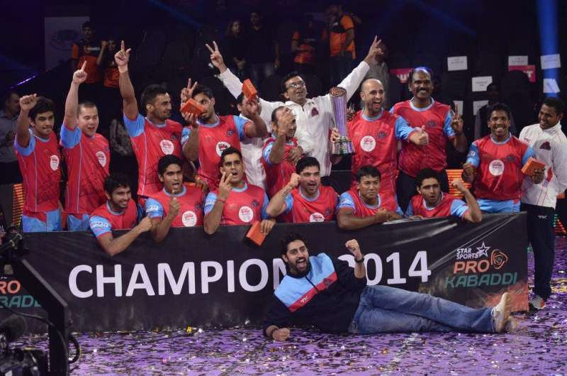 Jaipur Pink Panthers owner and Bollywood actor Abhishek Bachchan along with his team members celebrate after winning the finals of the Pro Kabaddi League against U Mumba in Mumbai on August 31, 2014. (Photo: IANS)