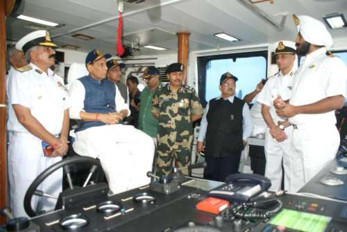 Union Home Minister Rajnath Singh onboard Coast Guard offshore patrol vessel ICGS Vijit in Porbandar of Gujarat on September 10, 2014. (Photo: IANS/PIB)
