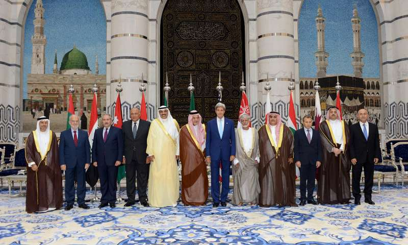 The foreign ministers of 10 Arab countries, Turkey and the United States pose for a group photo in Jeddah, Saudi Arabia