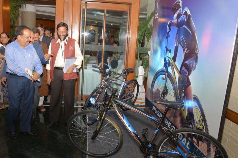 Union Minister for Health and Family Welfare Dr. Harsh Vardhan looks at a cycle during the release of a study report titled `Peddling towards a Greener India: A Report on Promoting Cycling in the Country` prepared by The Energy and Resources Institute (TERI), in New Delhi