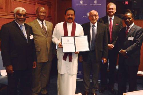 Commonwealth Secretary-General Kamalesh Sharma with Sri Lankan President Mahinda Rajapaksa  and others during the release of 2015-agenda