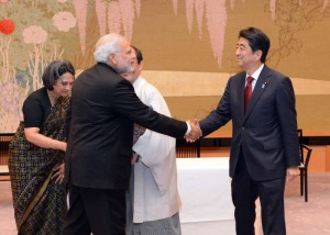 Prime Minister Narendra Modi (front L) shakes hands with Japanese Prime Minister Shinzo Abe during a signing ceremony to establish sister city ties between Kyoto and Varanasi in Kyoto, Japan