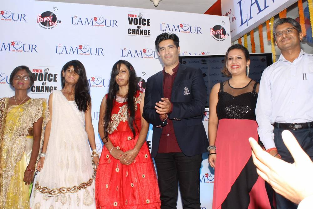 Fashion designer Manish Malhotra during a programme organised to felicitate acid attack survivors in Gurgaon, on Sept. 28, 2014. (Photo: Amlan Paliwal/IANS)