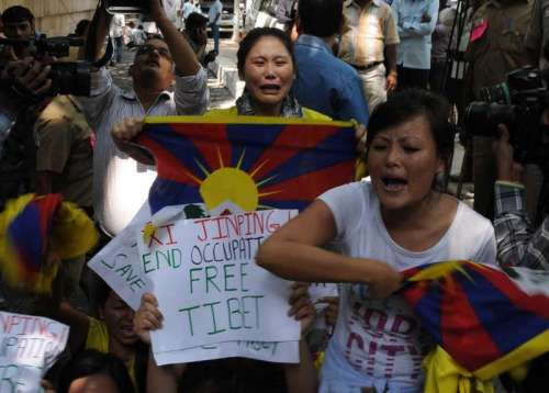 Tibetan refugees demonstrate against the visit of Chinese President Xi Jinping and to press for independence for Tibet in New Delhi.