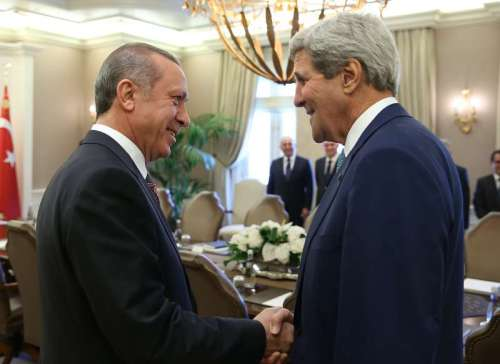 Turkish President Recep Tayyip Erdogan  meets with visiting United States Secretary of State John Kerry at the Presidential Palace in Ankara, Turkey.