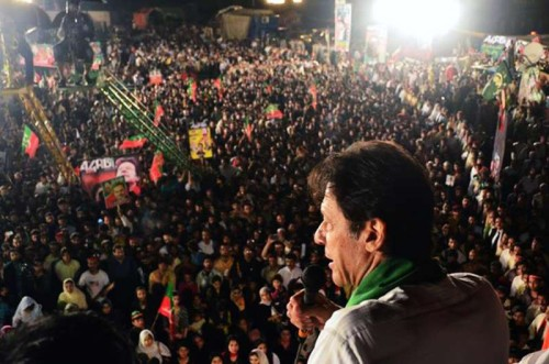 Leader of Pakistan Tehrik-e-Insaf party Imran Khan addresses supporters during an anti-government protest near the prime minister's residence in Islamabad, capital of Pakistan. An opposition party, which has staged anti-government sit-ins in Islamabad and demanded resignation of Prime Minister Nawaz Sharif, held talks with a government team on Friday to defuse the political tensions.