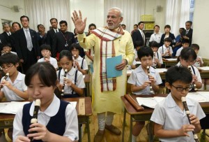 Prime Minister Narendra Modi interacts with children during his visit to Taimei Elementary School, in Tokyo, Japan on Sept 1, 2014. (Photo: IANS/PIB)