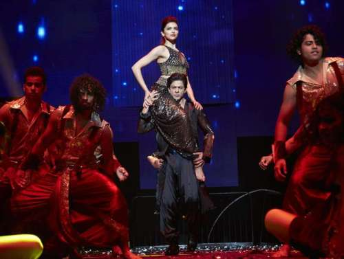 Actors Deepika Padukone and Shah Rukh Khan perform during `SLAM! - The Tour` in United States of America. Filmmaker Farah Khan, actors Malaika Arora Khan, Abhishek Bachchan, Boman Irani, Sonu Sood, Vivaan Shah and singers Kanika Kapoor and Honey Singh also performed in the programme organised at Toyota Center in Houston, and Continental Arena in New Jersey on 19th September and 20th September respectively.