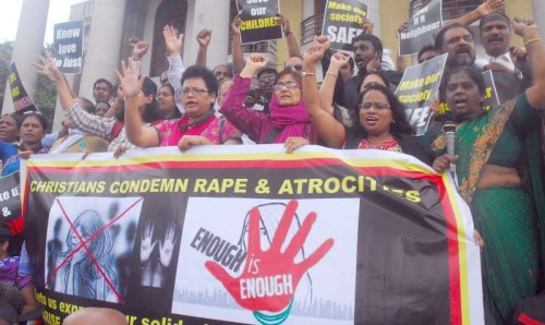 Bangalore Christian community protest condemning Rape and atrocities on women, expressing their solidarity against the Victims, demanding stringent punishment to Rapists in Bangalore on July 24, 2014. (Photo: IANS)