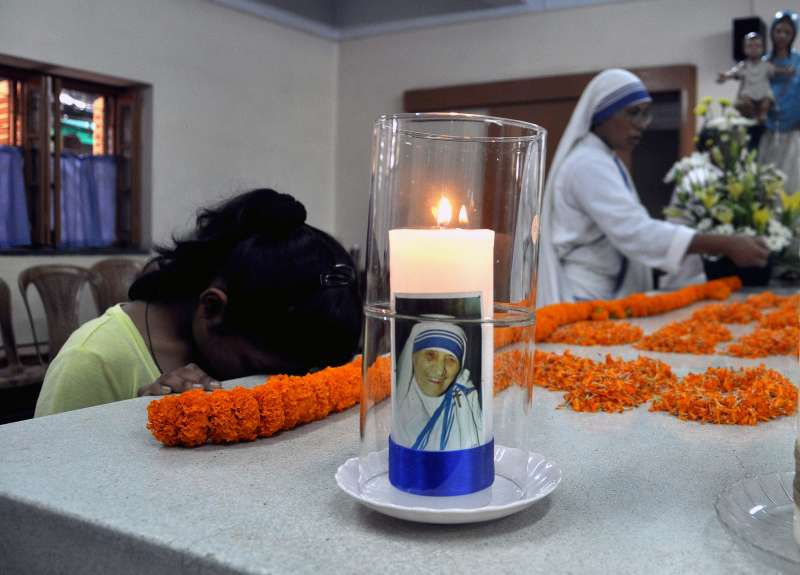 A woman during a service organised to commemorate the 17th death anniversary of Mother Teresa at Mother House in Kolkata