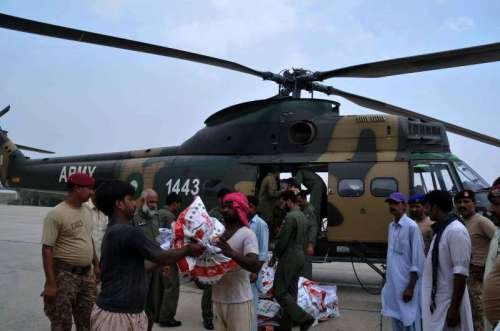 Pakistan army soldiers distribute food among flood-affected people in central Pakistan's Multan. Pakistan's military said that it had expanded the rescue and relief operation as floodwaters hit more districts in the country's Punjab province.