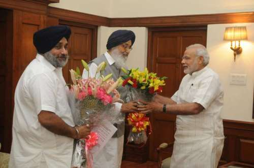 Punjab Chief Minister Parkash Singh Badal and state's Deputy Chief Minister Sukhbir Singh Badal call on Prime Minister Narendra Modi in New Delhi