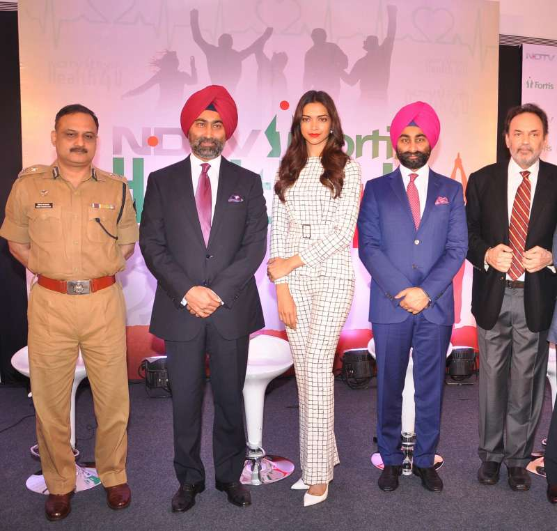 Actress Deepika Padukone with Dr. Prannoy Roy, Founder & Executive Co-Chairperson, NDTV Malvinder Mohan Singh, Executive Chairman, Fortis Healthcare, and Shivinder Mohan Singh, Executive Vice-Chairman, Fortis Healthcare and others at the launch of `NDTV Fortis Health4U` campaign in New Delhi on Sept 12, 2014. (Photo: IANS)