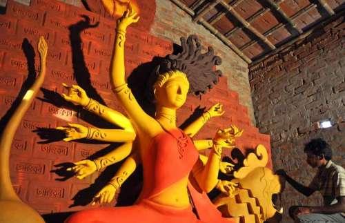 An artist busy working on a Durga idol ahead of Durga Puja in Kolkata