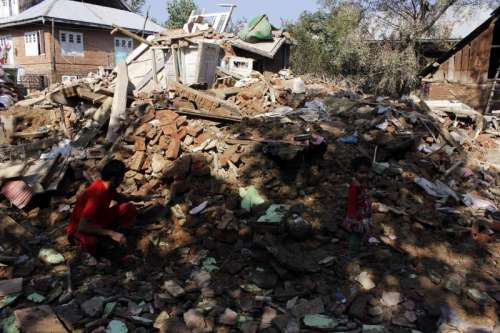 Debris of houses destroyed in the recent Jammu and Kashmir floods in Pampore of Jammu and Kashmir's Pulwama district.