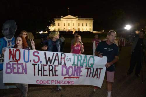 People participate in a demonstration protesting against military actions in Iraq and Syria, in front of the White House in Washington