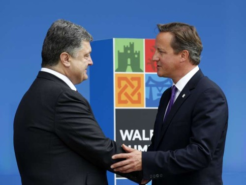 Ukrainian President Petro Poroshenko shakes hands with British Prime Minister David Cameron at the NATO Summit 2014 in Newport, Wales, the United Kingdom. The two-day NATO Summit 2014 kicked off in Wales