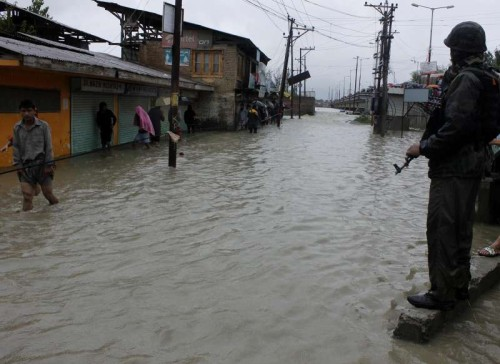 A soldier stands guard on the flooded streets of Hamdania Colony, Bemina in Srinagar