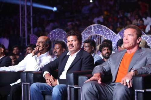 Actor Rajanikanth with Actor and former Governor of California (USA) Arnold Schwarzenegger at the audio launch of upcoming Tamil film ``I`` in Chennai