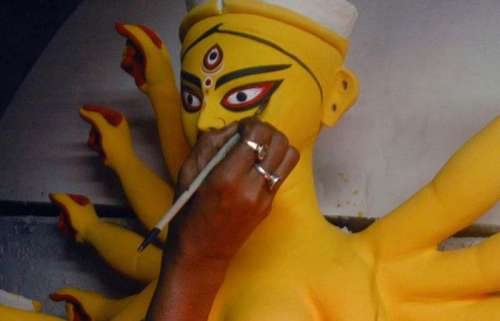 An artist paints the Durga idols at the Kumartoli workshop in Kolkata on Sept. 22, 2013. (Photo: IANS)