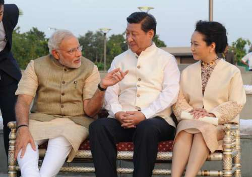Prime Minister Narendra Modi with the Chinese President Xi Jinping and the First Lady of the Republic of China, Peng Liyuan, at Sabarmati Waterfront, in Ahmedabad, Gujarat on September 17, 2014. (Photo: IANS/PIB)