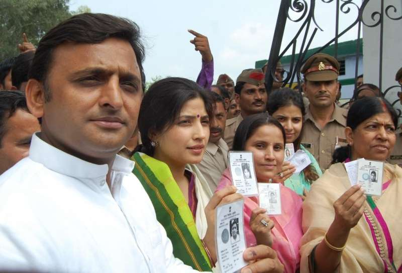 UP Chief Minister Akhilesh Yadav with wife and MP Dimple Yadav showing their voter Id during Lok Sabha by-poll in Mainpuri, Uttar Pradesh