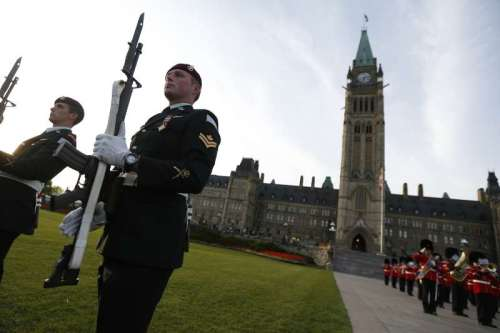 Soldiers perform during a ceremony marking the 100th anniversaries of the Princess Patricia's Canadian Light Infantry and the Royal 22nd Regiment, on Parliament Hill in Ottawa, Canada