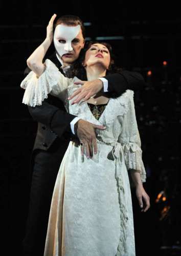 """Leading actor Brad Little and actress Claire Lyon perform at a rehearsal of the musical """"Phantom of the Opera"""" in Taipei, southeast China's Taiwan, Sept. 11, 2014. The musical will be on stage here from Sept. 11 to Sept. 28. (Xinhua/Wu Ching-teng) (lfj)"""