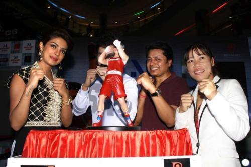 "Priyanka Chopra and Mary Kom at the launch of ""Mary Kom Doll"" of their latest hindi film ""Mary Kom""at Ambience Mall, in New Delhi on 02 September 2014.(Amlan Paliwal/IANS)"