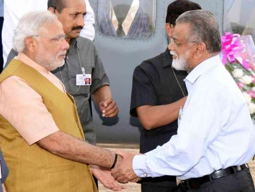 ISRO chairman K Radhakrishnan with  Prime Minister Narendra Modi at Sriharikota of Andhra Pradesh on June 29, 2014.